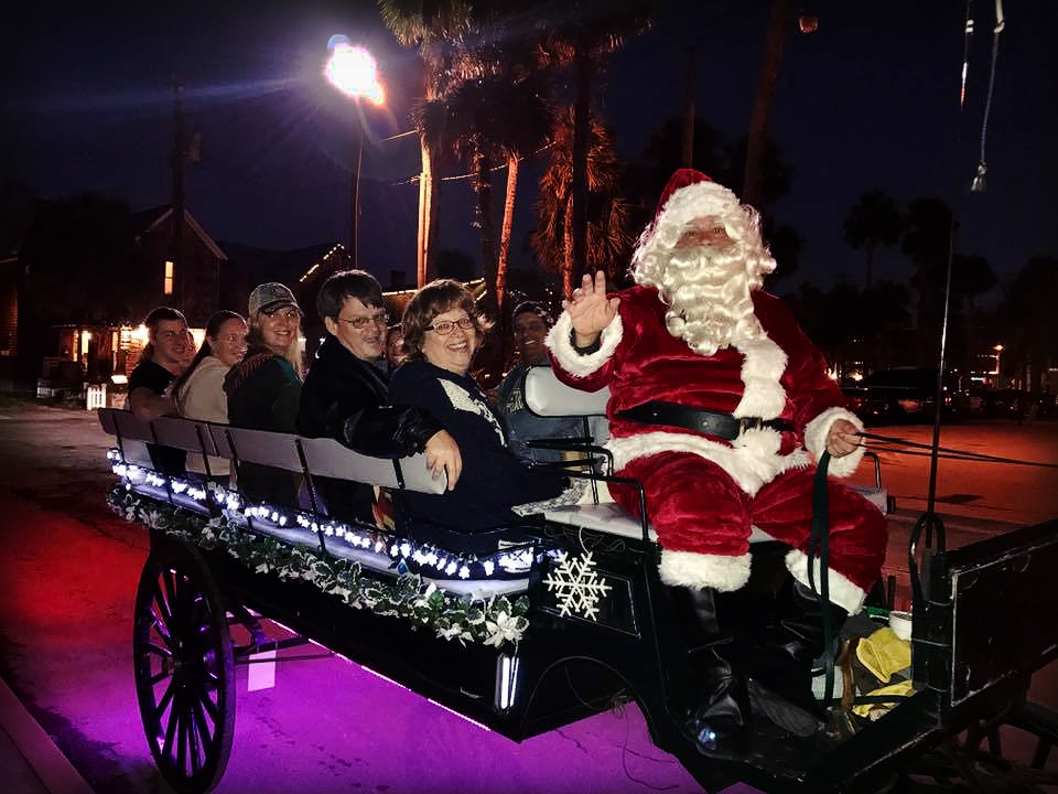 Santa Claus and a Group aboard The Tasting Tour Nights of Lights Holiday Tour