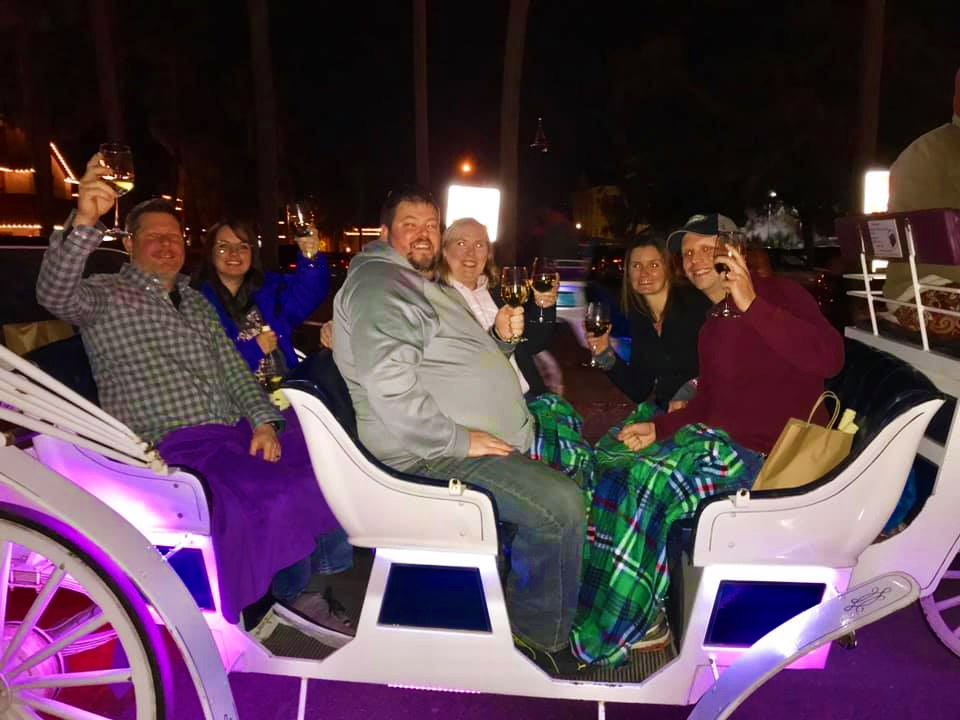 Group aboard The Tasting Tour Nights of Lights Holiday Tour Carriage