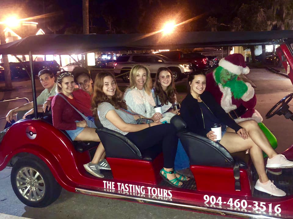 The Grinch and a Group aboard The Tasting Tour Nights of Lights Holiday Tour Roadster
