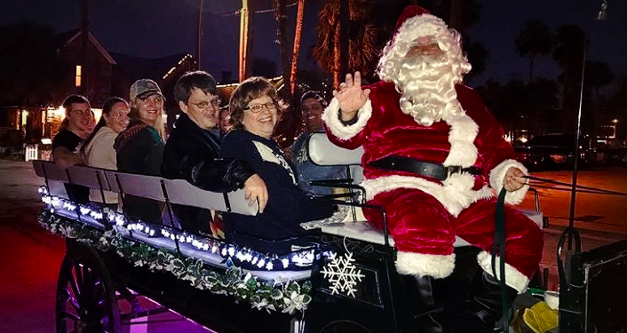 Santa Claus and a Group of patrons aboard The Tasting Tour Nights of Lights Holiday Tour