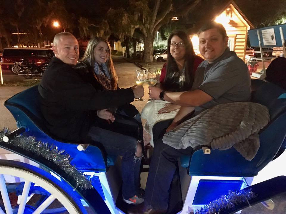 Group aboard  a Carriage for The Tasting Tour Nights of Lights Holiday Tour