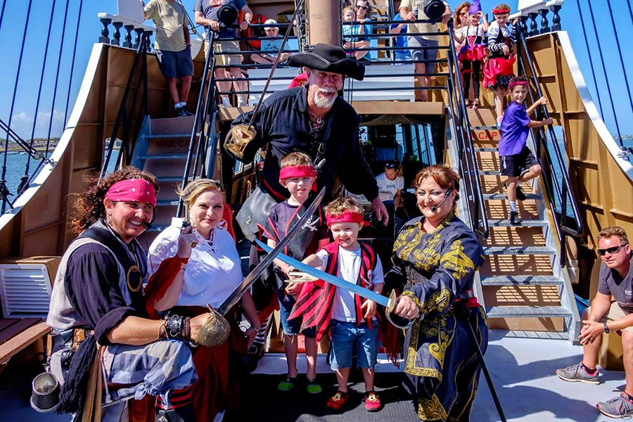 Group of pirates aboard Black Raven adventures in St. Augustine