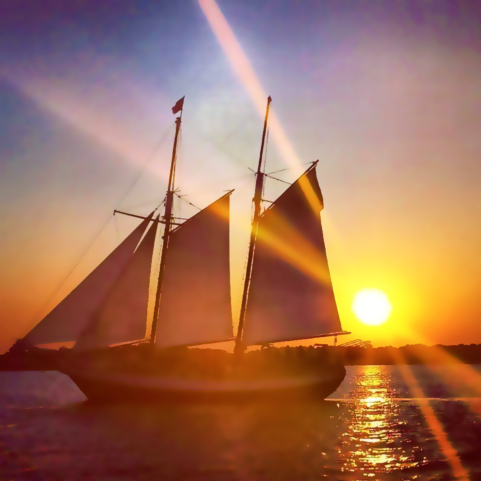 Sunset view looking at the Schooner Freedom sailing