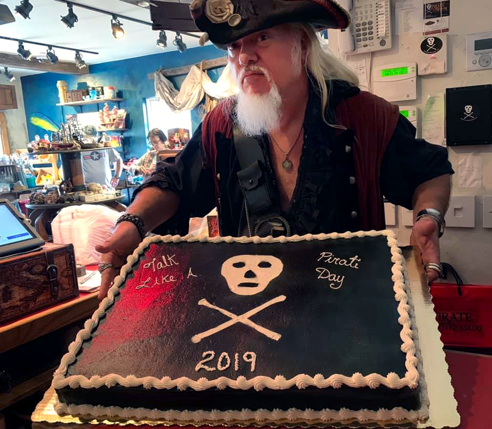 Pirate at St. Augustine Pirate Treasure Museum holding a cake stating